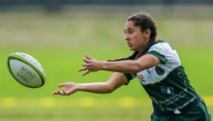 Young woman catching rugby