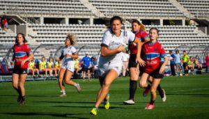 high school girls playing rugby