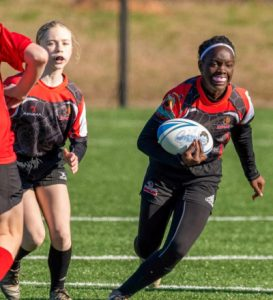 Young women playing rugby