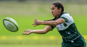 Image of young woman playing rugby